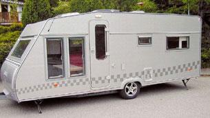 Man kan knappt känna igen den gamla Kabe-vagnen efter att den fått ny färg, nya fönster och en ny dörr